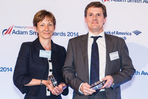 Jo Woods of Boston Consulting Group collecting the Award on behalf of Mark Salehar and David McGowan of BNP Paribas