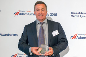 Mark Johnson from Reval collecting the award on behalf of Debdatta Banerjee and Ian Gibson, eBay Inc.