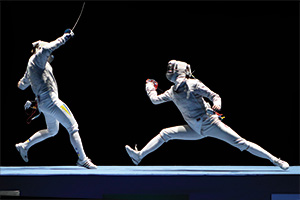 Two people fencing against each other