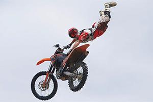 Photo of a biker doing risky tricks