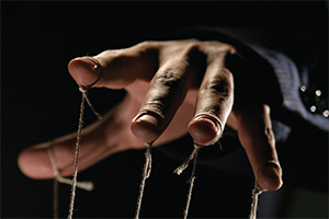 Hand with puppet strings