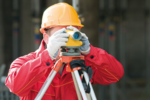 Surveyor looking through a theodolite