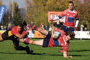 Rugby players tackling