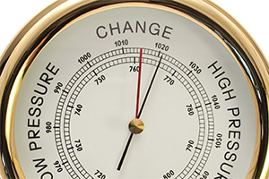 Brass barometer pointing to change