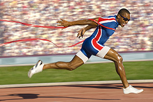 Track runner crossing the finish line