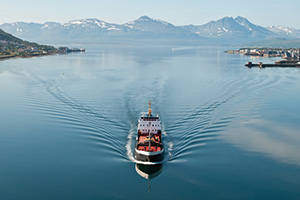 Ship in Norway with beautiful mountain background