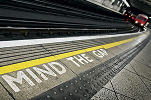 Mind the gap written on the train station platform