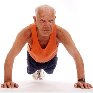 Older man in orange vest doing press-ups