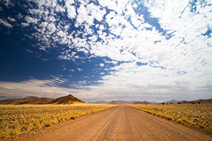 Photo of a gravel road in an open space in Namibia