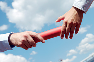 Business people passing the baton
