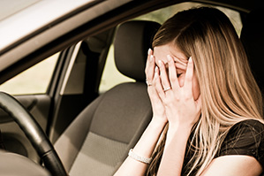 Depressed woman in car