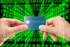 Credit card held in front of matrix style binary