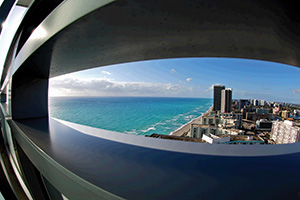 View through barrier with a fish eye lens overlooking south Florida skyline
