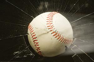 Baseball smashing through a window