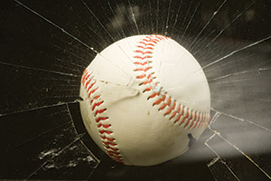 Baseball smashing through a window