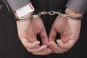 Man handcuffed with the ace of hearts up his sleeve