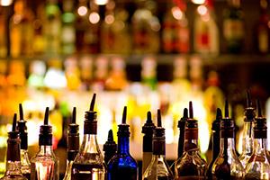 Photo of many liquor bottles at a bar