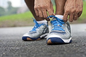 Photo of a runner tying up their sports shoes