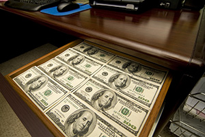 Photo of a drawer filled with money