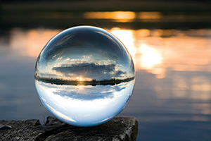 Photo of a glass ball with a lake landscape in the background