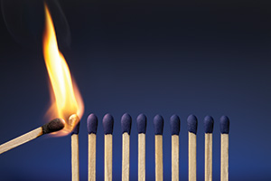 A single match lighting a row of matches