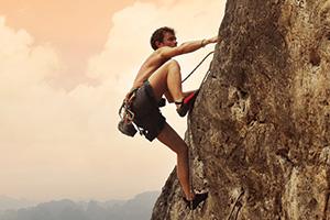 Young man climbing a limestone wall