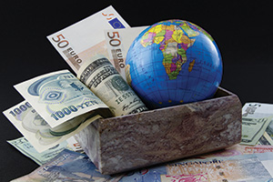 Money and a globe in a box to symbolise the world bank