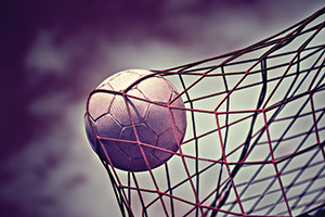 Soccer ball at the back of the net