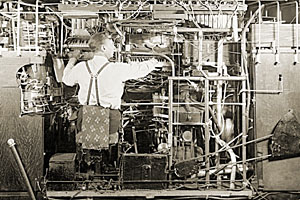 Vintage photo of a Man Working On Complex Machine