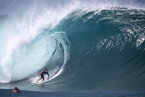 Man surfing big wave in Hawaii