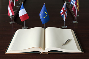 European Union flags and a blank book