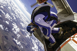 Skydiver rolling out of a plane