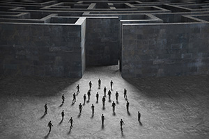 People entering mysterious concrete maze