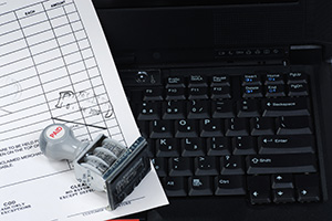 Paid stamp on document and keyboard