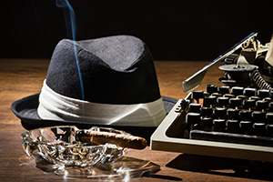 Gangters hat, smoking cigar and manual typewriter