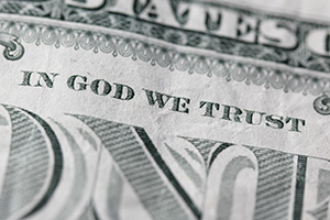 """In God we trust"" close up on a dollar note"