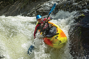 Kayaker going down a waterfall