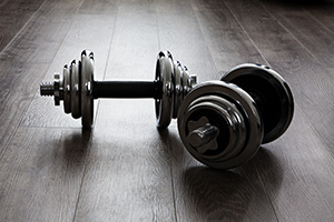 Two weights sitting in the middle of a room