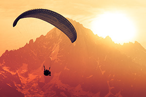 Glider in the mountain landscape in sunset