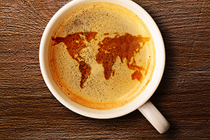 Cup of coffee with a map in the foam