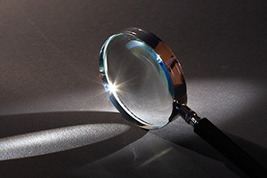 Magnifying glass reflecting the light