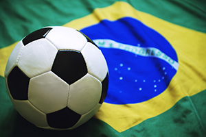 Football on top of the Brazilian flag