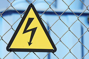 High voltage sign on a wired fence