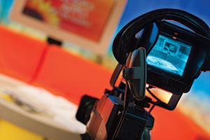 Video camera recording TV show in the studio