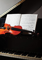 String instruments on a piano