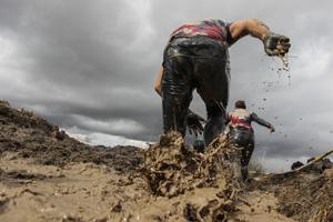 mud runners in a muddy race