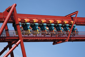 Roller coaster car climbing lift hill