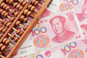 Renminbi underneath abacus