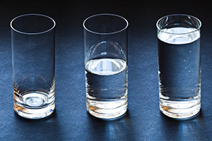Three glasses filled to different amounts