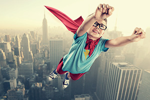 Little superhero ready flying over city